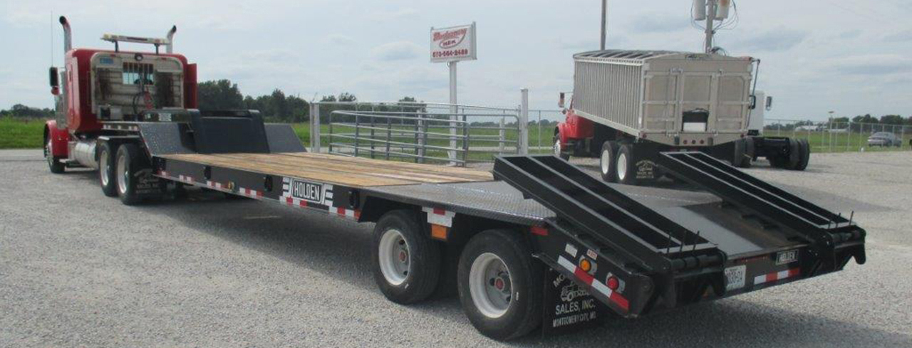 Flat Bed Trailer equipped to haul heavy loads